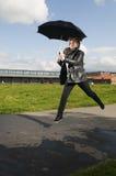 Jump with umbrella Royalty Free Stock Photo