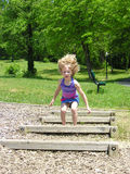 Jump Up. A young girl jumps up with her hair flying everywhere Stock Photos