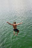 Jump into the water. Young man jumping into the water Stock Photos
