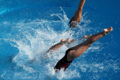 Jump into water 2. A girl jump in water in a competition Royalty Free Stock Photography