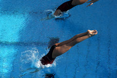 Jump into water. A girl jump in water in a competition Royalty Free Stock Photography