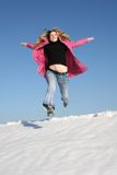 Jump winter girl Stock Photo