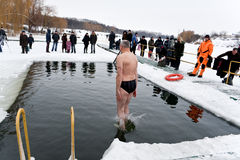 Jump of winter swimmer Royalty Free Stock Images