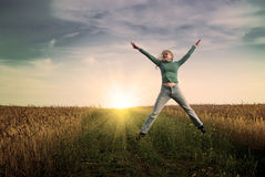 Jump women in wheat field Stock Photography