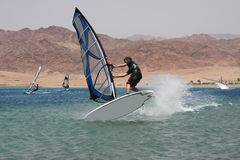Jump. Young windsurfer. Royalty Free Stock Photography