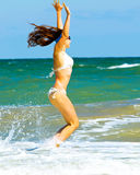 Jump young woman on the beach Royalty Free Stock Photography