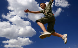 Jump2. Young boy jumping stock images