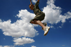 Jump3. Young boy jumping stock image