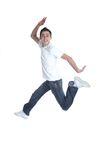 Jumper. Funny young man in the air / little blur on feet / shutter 1/200s stock photography
