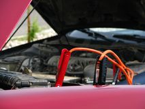 Jumper Cables. Being used to jump-start a car Royalty Free Stock Photography