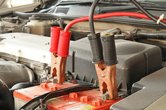 Jumper cables on a car Royalty Free Stock Photos
