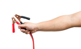Jumper cables in male hand isolated on white Stock Images