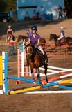 Jumper - Crossed Beams. Equestrian Event - Jumper goes over crossed beams Stock Photo