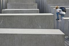 Jumper at the holocaust memorial berlin Stock Images