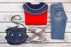 Jumper, jeans, sneakers and bag Royalty Free Stock Photos