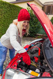 Jumper by jumper cables Royalty Free Stock Photo