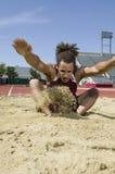 Jumper Landing In Sand Pit longo fotografia de stock royalty free