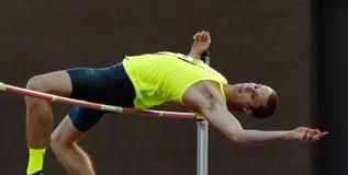 Jumper Male Athlete alto Foto de Stock
