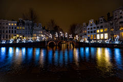 Jumper over the canal at Amsterdam royalty free stock images