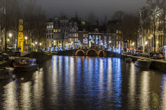Jumper over the canal at Amsterdam stock images