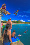 Jumper in Waikiki Pier Royalty Free Stock Photos