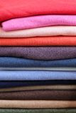 Jumpers. Big pile of vivid color sweaters and jumpers Stock Photo