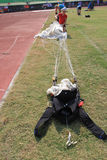 Jumpers folded parachute. The jumpers folded parachute after landing in the stadium in the city of Solo, Central Java, Indonesia Stock Photography