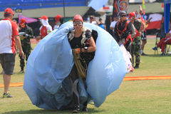 Jumpers folded parachute. The jumpers folded parachute after landing in the stadium in the city of Solo, Central Java, Indonesia Royalty Free Stock Photos