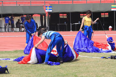 Jumpers folded parachute. The jumpers folded parachute after landing in the stadium in the city of Solo, Central Java, Indonesia Royalty Free Stock Image