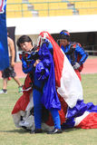 Jumpers folded parachute. The jumpers folded parachute after landing in the stadium in the city of Solo, Central Java, Indonesia Royalty Free Stock Photography