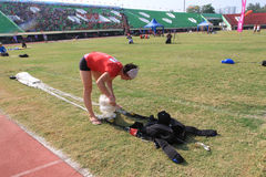 Jumpers folded parachute. The jumpers folded parachute after landing in the stadium in the city of Solo, Central Java, Indonesia Stock Photos