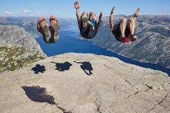 Jumpers on Preikestolen rock. Norway landmark. Astonishing photo. Lysefjorden Stock Image