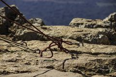 Jumpers with tied ropes is slaughtered in stone . Mountaineering. Snapling royalty free stock photo