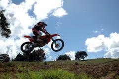 Jumping. Motorcross rider jumping Royalty Free Stock Image