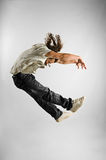Jumping. Young men make acrobatic jump Stock Photo