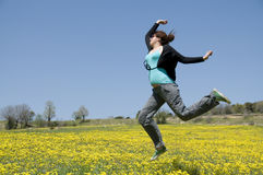 Jumping. Young girl jump in field Royalty Free Stock Photography