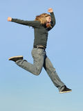 Jumping. Delighted girl doing a big jump Royalty Free Stock Photography