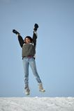 Latin Girl Jumping Outdoors in a Winter Day Stock Images
