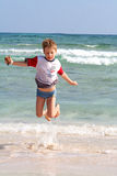 Jumping. Little boy on a beach in spain royalty free stock photography
