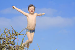 Jumping. Little boy on a beach in spain stock image