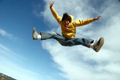 Jumping. Young man jumping with a big smile royalty free stock images