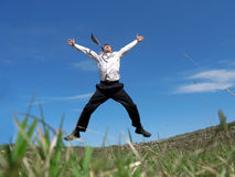 Jumping. Businessman jumping in the air with success stock image