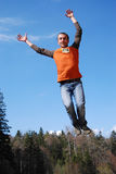 Jumping. Great jump of young man Royalty Free Stock Photo