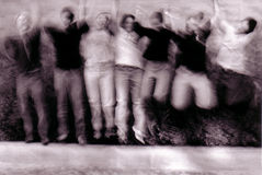 Jumping. Group of people holding hands and jumping in the air Stock Photos