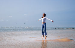 Jumping-4. Girl jumping on an islet Stock Photo