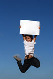 Jumping. Happy smiling child jumping with sign Stock Photos