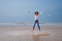 Jumping-5. Girl jumping on an islet Stock Photos