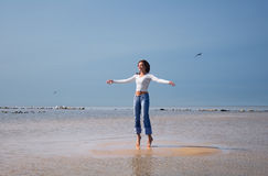 Jumping-6. Girl jumping on an islet Stock Images