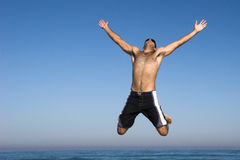 Jumping. Man jumping on the beach royalty free stock image