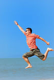 Jumping. Young Man Jumping in the beach Royalty Free Stock Photography